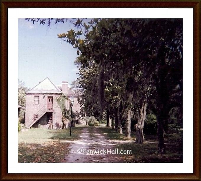5.11.1999 Edward Fenwick's Carriage house as left by Fenwick Hall Hospital in very rough shape.  Note missing shingles on the roof.  Row of very old Magnolia trees planted by the Morawetz.  Photo courtesy of Carol Dawn